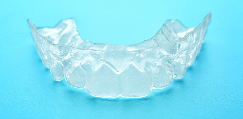 dental-night-guard-on-blue-background